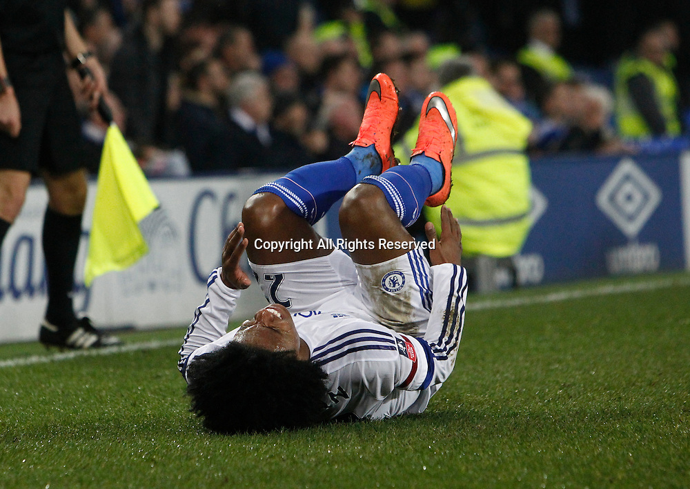 12.03.2016. Goodison Park, Liverpool, England. Emirates FA Cup 6th Round. Everton versus Chelsea. Chelsea midfielder Willian rolls in agony after a strong challenge by Everton defender Leighton Baines.