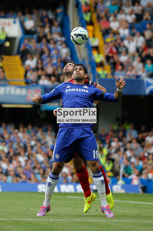 19 FW Diego Costa chests the ball down away from 2 DFJordi Amat | Chelsea v Swansea City - Stamford Bridge -  Barclays Premier League - 13/09/2014  | Andy Walter (c) Sportpix.org
