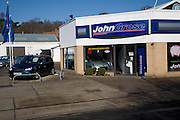 John Grose.  Second hand used cars for sale on garage forecourt