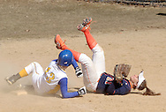 SUNY Orange outfielder Kaitlyn Andryshak falls over Shannon Kelly of Gloucester County College at first base during a women's softball game on March 30, 2008.