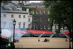 The 41-gun Royal Salute to mark the anniversary of the Queen's Coronation. The salute is fired by The King's Troop, Royal Horse Artillery at Horse Guards Parade as part of the Queen's Diamond Jubilee weekend, Saturday June 2, 2012. Photo By Andrew Parsons/i-Images
