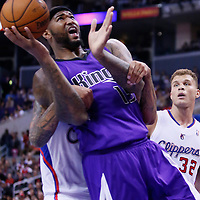 25 October 2013: Sacramento Kings center DeMarcus Cousins (15) is fouled by Los Angeles Clippers small forward Matt Barnes (22) during the Sacramento Kings 110-100 victory over the Los Angeles Clippers at the Staples Center, Los Angeles, California, USA.