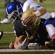 LEVITTOWN, PA - OCTOBER 31: Truman's Trysten Hunt lands on the end zone line and scores a touchdown against Norristown in the second quarter at Harry S. Truman high school  October 31, 2014 in Levittown, Pennsylvania. (Photo by William Thomas Cain/Cain Images)