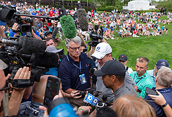 May 29, 2019 - Dublin, OH, U.S. - DUBLIN, OH - MAY 29: Tiger Woods (black hat) and former NFL quarterback Peyton Manning (white hat) answer questions from the media after completing the Pro-Am of the Memorial Tournament presented by Nationwide at Muirfield Village Golf Club on May 30, 2018 in Dublin, Ohio. (Photo by Adam Lacy/Icon Sportswire) (Credit Image: © Adam Lacy/Icon SMI via ZUMA Press)
