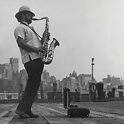 Saxaphone player on  Pier 16, lower Manhattan. 1973