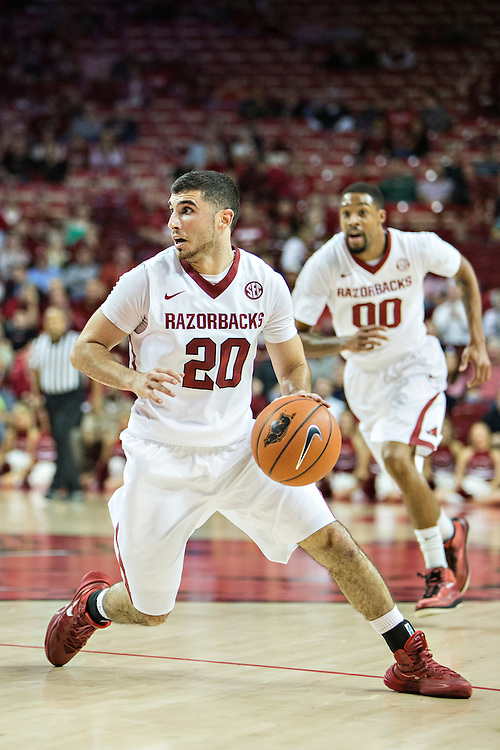FAYETTEVILLE, AR - DECEMBER 3:  Kikko Haydar #20 of the Arkansas Razorbacks dribbles the ball against the SE Louisiana Lions at Bud Walton Arena on December 3, 2013 in Fayetteville, Arkansas.  (Photo by Wesley Hitt/Getty Images) *** Local Caption *** Kikko Haydar