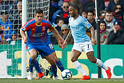 Manchester City midfielder Raheem Sterling (7) attacks, Crystal Palace defender Scott Dann (6) defends, during the Premier League match between Crystal Palace and Manchester City at Selhurst Park, London, England on 14 April 2019.