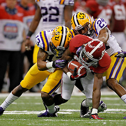 Jan 9, 2012; New Orleans, LA, USA; LSU Tigers defensive back Tharold Simon (24) and cornerback Ron Brooks (13) tackles Alabama Crimson Tide wide receiver Kevin Norwood (83) during the first half of the 2012 BCS National Championship game at the Mercedes-Benz Superdome.  Mandatory Credit: Derick E. Hingle-US PRESSWIRE