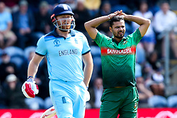 Mashrafe Mortaza of Bangladesh cuts a frustrated figure as Jonny Bairstow of England  looks on - Mandatory by-line: Robbie Stephenson/JMP - 08/06/2019 - CRICKET - Cardiff Wales Stadium - Cardiff , England - England v Bangladesh - ICC Cricket World Cup 2019 Group Stage