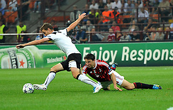 28.09.2011, Stadion Giuseppe Meazza, Mailand, ITA, UEFA CL, Gruppe H, ITA, UEFA CL, AC Mailand (ITA) vs FC Viktoria Pilsen (CZE), im Bild MArek BAKOS Plzen, Mark VAN BOMMEL Milan. // during the UEFA Champions League game, group H, AC Mailand (ITA) vs FC Viktoria Pilsen (CZE) at Giuseppe Meazza stadium in Mailand, Italy on 2011/09/28. EXPA Pictures © 2011, PhotoCredit: EXPA/ InsideFoto/ Alessandro Sabattini +++++ ATTENTION - FOR AUSTRIA/(AUT), SLOVENIA/(SLO), SERBIA/(SRB), CROATIA/(CRO), SWISS/(SUI) and SWEDEN/(SWE) CLIENT ONLY +++++