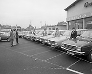 Tubberware Girls - New Cars 31/05/1976<br /> 05/31/1976<br /> 31st May 1976<br /> Pictured from left to right Michael Rowe, Managing Director  Crawfords Dun Laoghaire, Loise Coleman, Tupperware Distributor, Michael Rowe, Managing Director, Chrysler (Ireland) Limited, Kay Magee, Mary Anderson, Eileen Halre, Marie Fely - Henry, Brid Molone, Maureen Monaghan and Elizabeth Farrell. The cars in the picture are Hillman Hunters.