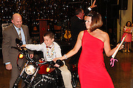 Cancer warrior Kayleigh Crabtree, 11 of Beavercreek (right) looks on as fellow cancer warrior Zachary Meredith, 9 of Springboro tries out the Harley-Davidson Iron Sportster 883 donated by Buckeye Harley-Davidson for the live auction during CHA-CHA 2013, benefiting Dayton Children's Medical Center, held at Sinclair Community College's Ponitz Center, Saturday, May 11, 2013.