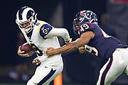 HOUSTON, TX - AUGUST 29:  Brandon Allen #8 of the Los Angeles Rams tries to avoid the rush of Jamal Davis II #49 of the Houston Texans during week four of the preseason at NRG Stadium on August 29, 2019 in Houston, Texas. The Rams defeated the Texans 22-10.   (Photo by Wesley Hitt/Getty Images) *** Local Caption *** Brandon Allen; Jamal Davis II