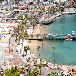 Catalina Island Avalon waterfront aerial photo. Picture includes Avalon Bay, Avalon seaside buildings, and the Green Pleasure Pier. Catalina Island is a popular travel destination off the coast of Southern California in the United States.