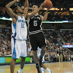 29 March 2009: San Antonio Spurs forward Ime Udoka (5) goes to the basket as New Orleans Hornets center Hilton Armstrong (12) defends the play during a 90-86 victory by the New Orleans Hornets over Southwestern Division rivals the San Antonio Spurs at the New Orleans Arena in New Orleans, Louisiana.