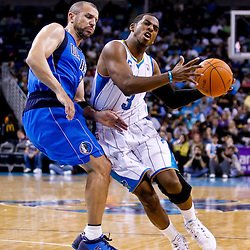November 17, 2010; New Orleans, LA, USA; New Orleans Hornets point guard Chris Paul (3) draws a foul from Dallas Mavericks point guard Jason Kidd (2) during the second half at the New Orleans Arena. The Hornets defeated the Mavericks 99-97. Mandatory Credit: Derick E. Hingle