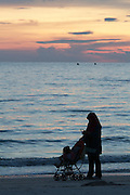 Malaysia, Langkawi. Meritus Pelangi Beach Resort & Spa. Local mom enjoying sunset at the beach.