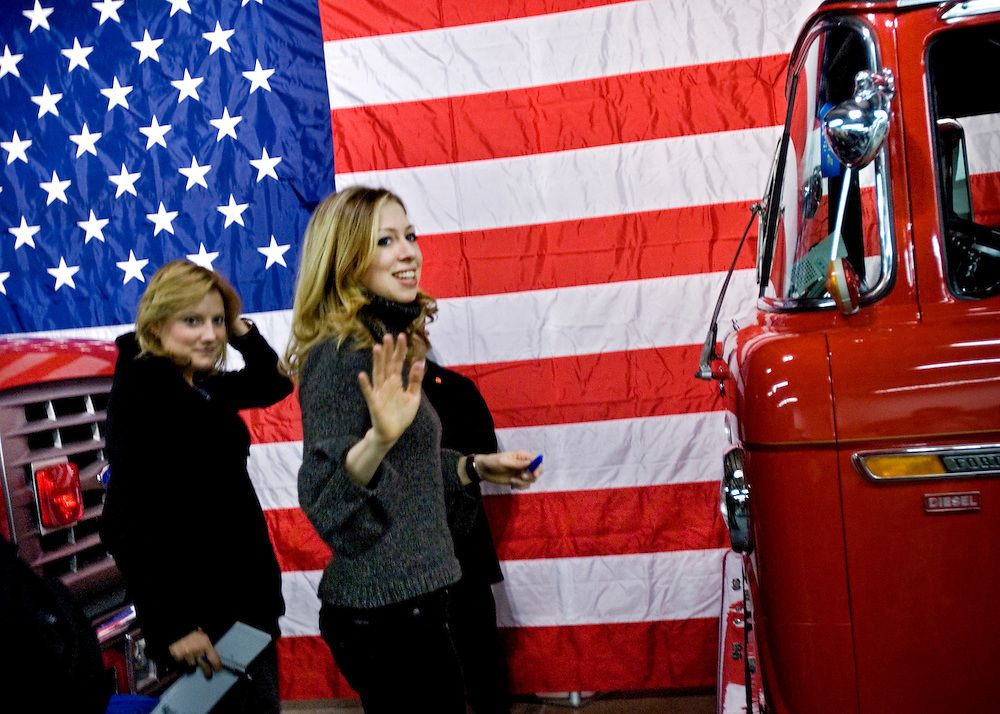 Hillary Clinton event at the local volunteer fire station in the small town Washington, Iowa. Hilary Clinton's daughter Chelsea waves to the audience as she is leaving the event...Photo by Chris Maluszynski /MOMENT