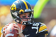 August 31 2013: Iowa Hawkeyes quarterback Jake Rudock (15) warms up with the team before the start of the NCAA football game between the Northern Illinois Huskies and the Iowa Hawkeyes at Kinnick Stadium in Iowa City, Iowa on August 31, 2013. Northern Illinois defeated Iowa 30-27.