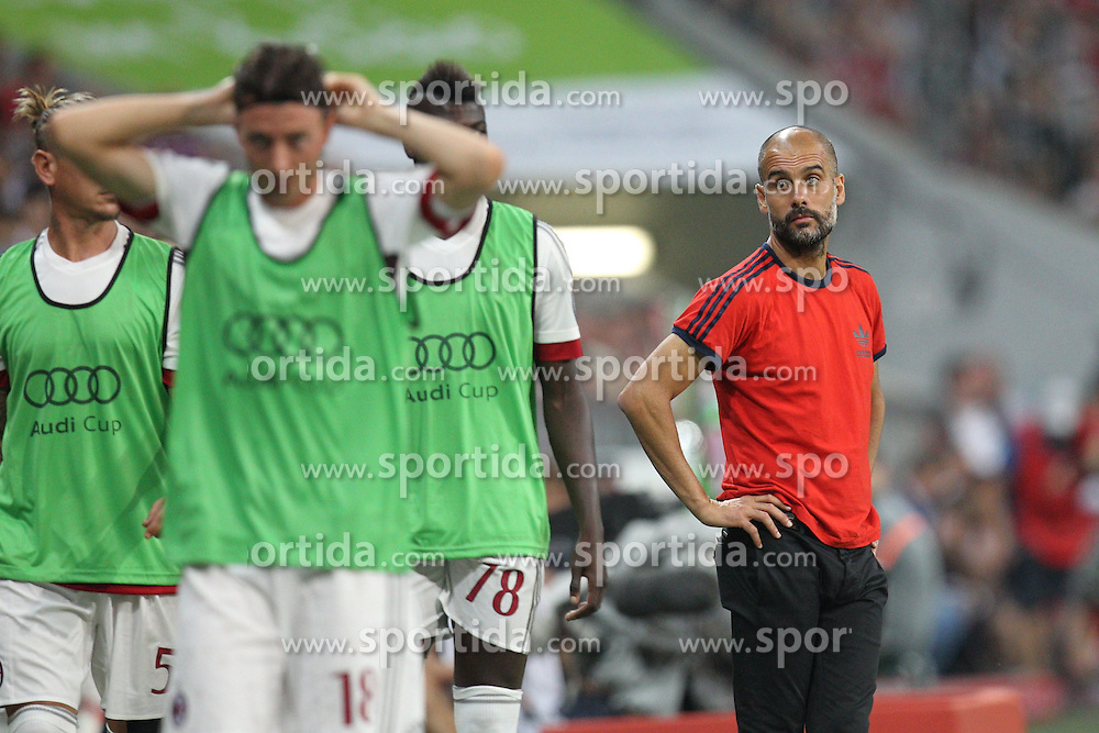 04.08.2015, Allianz Arena, Muenchen, GER, AUDI CUP, FC Bayern Muenchen vs AC Mailand, im Bild Chef-Trainer Pep Guardiola (FC Bayern Muenchen) schaut den Ersatzspielern nach // during the 2015 AUDI Cup Match between FC Bayern Muenchen and AC Mailand at the Allianz Arena in Muenchen, Germany on 2015/08/04. EXPA Pictures &copy; 2015, PhotoCredit: EXPA/ Eibner-Pressefoto/ Kolbert<br /> <br /> *****ATTENTION - OUT of GER*****