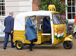 LONDON- UK - 26-MAR-2015: The Prince of Wales and The Duchess of Cornwall, Joint Presidents of Elephant Family, host a reception to launch the 'Travels to My Elephant' Rickshaw Race, Clarence House, London. During the event Their Royal Highnesses viewed the first two completed rickshaws taking part in the race. <br /> Photograph by Ian Jones
