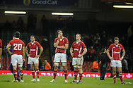 Wales players  Mike Phillips (l), Luke Charteris ©, Bradley Davies & Rhys Priestland ®  show their dejection after losing the match.Dove Men series, autumn international rugby international, Wales v Samoa at the Millennium stadium,  Cardiff in South Wales on Friday 16th November 2012.  pic by Andrew Orchard, Andrew Orchard sports photography,