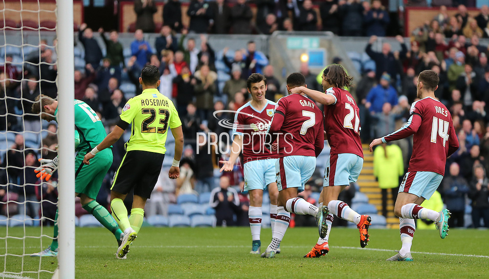 Burnley striker Andre Gray (7) scores from the penalty spot and celebrates during the Sky Bet Championship match between Burnley and Brighton and Hove Albion at Turf Moor, Burnley, England on 22 November 2015.