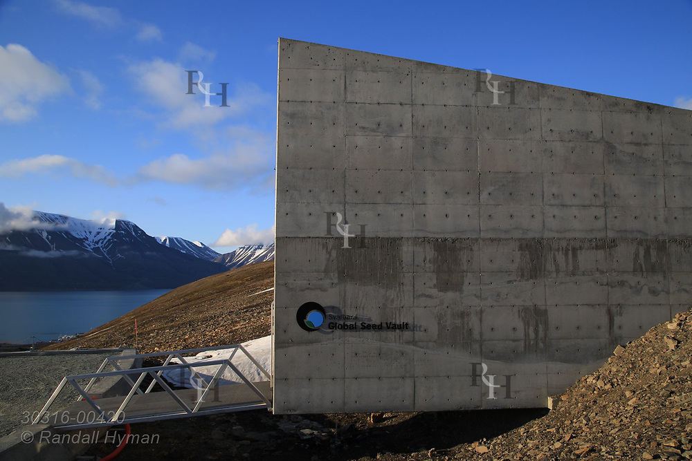 Global Seed Vault juts from rocky hillside in mid summer in Longyearbyen on Spitsbergen island, Svalbard, Norway.