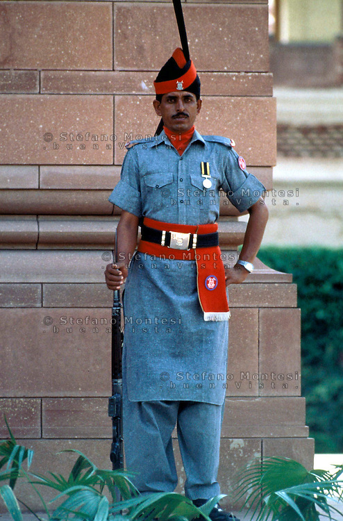 Pakistan  Lahore  1986..Guardsman with moustache in uniform with medals and rifle