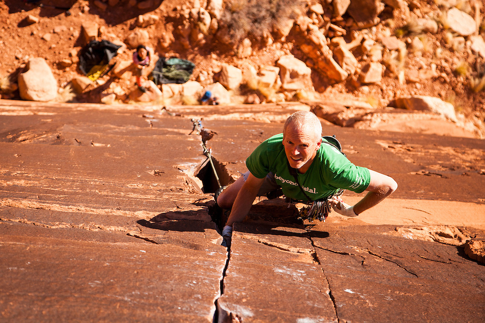 "Paul Shilton looks ahead while climbing ""Idiot Wind"", 5.11c, Dylan Wall, San Rafael Swell, Utah."