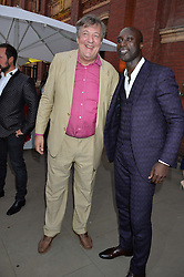 Left to right, STEPHEN FRY and OZWALD BOATENG at the V&A Summer Party in association with Harrod's held at The V&A Museum, London on 22nd June 2016.