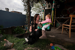 UK ENGLAND LONDON 3MAY16 - London Canal boat resident Colette Coburn with her daughter Lyra and dog Sparky poses for a photo at their canalboat near Tottenham, east  London.<br /> <br /> <br /> jre/Photo by Jiri Rezac<br /> <br /> <br /> © Jiri Rezac 2016