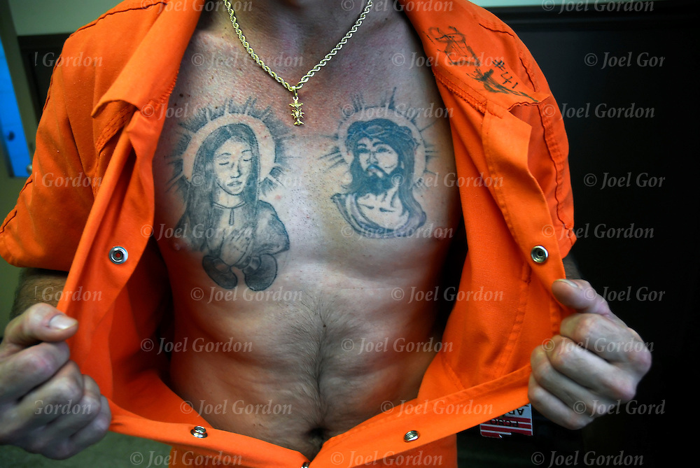 Trusty inmate shows off his jail house tattoos in the Putnam County Jail FL detainees