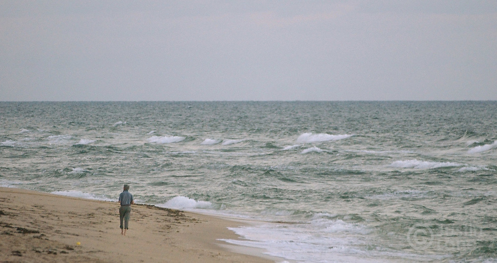 United States Senator and Democratic Candidate for President John Kerry takes a solitary walk along the beach outside of his hotel in West Palm Beach, FL Monday, 18 Oct, 2004. Kerry is campaigning in Florida today...EPA/JUSTIN LANE