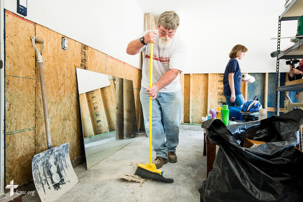 Bob Myers helps clean the home of Rev. Randy Blankschaen, pastor of Immanuel Lutheran Church, and his wife Lydia, at the pastor's home in Pensacola, Fla., on Saturday, May 3, 2014. A torrential rainfall severely damaged the house and surrounding neighborhood. LCMS Communications/Erik M. Lunsford
