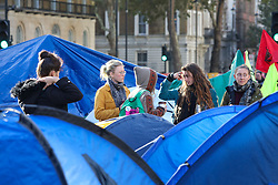 © Licensed to London News Pictures. 08/10/2019. London, UK. Extinction Rebellion sit-in at Westminster where up to two weeks of protest are planned. Protestors in Trafalgar Square. Photo credit: Alex Lentati/LNP