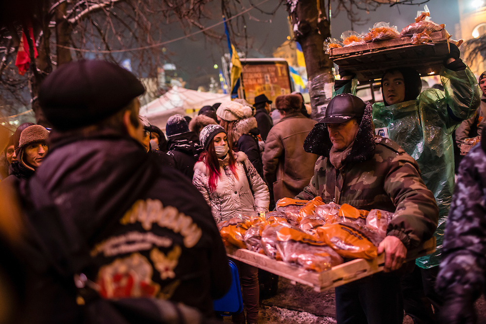 KIEV, UKRAINE - DECEMBER 11: Anti-government protesters deliver bread to the Trade Unions building, which functions as a headquarters for the opposition movement, on December 11, 2013 in Kiev, Ukraine. Thousands of people have been protesting against the government since a decision by Ukrainian president Viktor Yanukovych to suspend a trade and partnership agreement with the European Union in favor of incentives from Russia. (Photo by Brendan Hoffman/Getty Images) *** Local Caption ***
