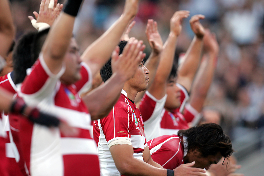 The dejected Japanese players applaud the fans at the end of the game.  Fiji v Japan, Pool B, Match 11, Pool B. 12th September 2007. Stadium De Toulouse, Toulouse, France.