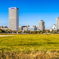 Panoramic photo of Milwaukee skyline with Lakeshore State Park. Picture includes the US Bank building, University Club Tower, and Northwestern Mutual Tower. Lakeshore State Park is a Wisconsin State Park near downtown Milwaukee on Lake Michigan. High resolution panoramic photo ratio is 1:3.