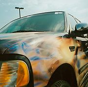 Truck with a paint job of different colours USA