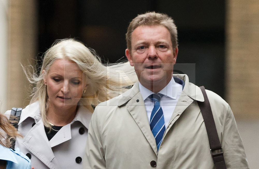 © Licensed to London News Pictures. 15/10/2018. London, UK.  CRAIG MACKINLAY with his wife, Kati arrives at Southwark Crown Court in London for a trial in connection with charges of illegal election spending during the 2015 general election. South Thanet MP Craig Mackinlay, 51, campaign director Marion Little, 63, and election agent Nathan Gray, 29, have each been charged with offences under the Representation of the People Act 1983.  Photo credit: Vickie Flores/LNP