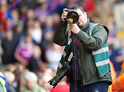 LIVERPOOL, ENGLAND - Saturday, October 5, 2013: Photographer Peter Powell during the Premiership match against Crystal Palace at Anfield. (Pic by David Rawcliffe/Propaganda)