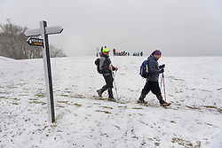 © Licensed to London News Pictures. 12/02/2017. Princess Risborough, UK. A group of walkers brave cold temperatures as they walk through a snow covered landscape on The Ridgeway, near  Princess Risborough, Buckinghamshire, south east England, as large parts of the UK wake to freezing temperatures and snowfall over night. Photo credit: Ben Cawthra/LNP