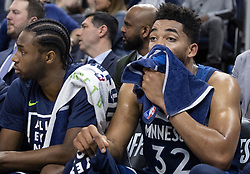 April 23, 2018 - Minneapolis, MN, USA - Minnesota Timberwolves' Andrew Wiggins (22) and Karl-Anthony Towns (32) watch from the bench in the final minute of the game against the Houston Rockets Monday, April 23, 2018 at the Target Center in Minneapolis, Minn. The Rockets won, (Credit Image: © Carlos Gonzalez/TNS via ZUMA Wire)