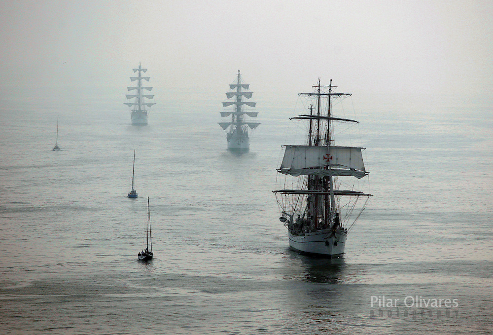 Portugal registered sailing ship Sagres (R), followed by other ships, takes part in the Bicentennial Regatta boat race in Callao Bay, April 27, 2010. The regatta is held to celebrate 200 years of independence in some Latin American countries.   .REUTERS/Pilar Olivares (PERU - Tags: SPORT YACHTING IMAGES OF THE DAY)