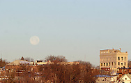 Middletown, NY  - The full moon sets over buildings on the morning of Dec. 24, 2007.