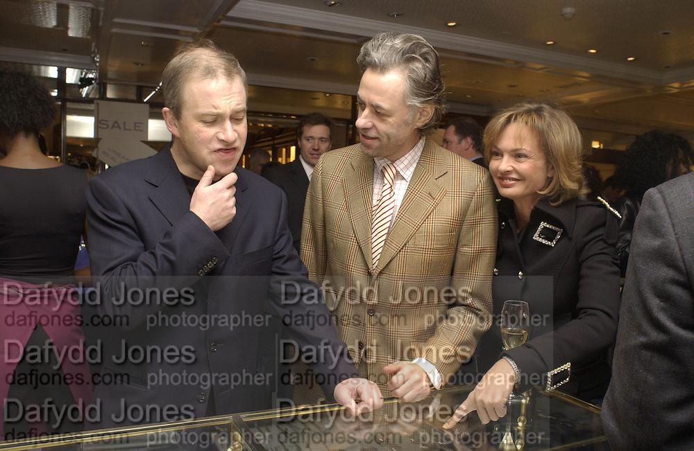 Harry Enfield, Geldof and Maya de Schonburg.  Charity sale of the last ever sale at Asprey and Garrard. New Bond St. London. 15/1/02© Copyright Photograph by Dafydd Jones 66 Stockwell Park Rd. London SW9 0DA Tel 020 7733 0108 www.dafjones.com