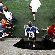 Eric Hagarty #13 of the Boston Cannons runs onto the field prior to the game at Harvard Stadium on May 10, 2014 in Boston, Massachusetts. (Photo by Elan Kawesch)
