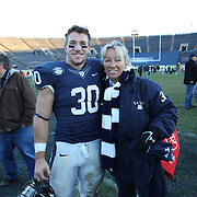 Yale running back Tyler Varga, with his mom Hannele after the Yale Vs Princeton, Ivy League College Football match at Yale Bowl, New Haven, Connecticut, USA. 15th November 2014. Photo Tim Clayton