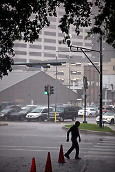 12 June  2015. New Orleans, Louisiana. <br /> heavy rain falls Downtown.<br /> Photo©; Charlie Varley/varleypix.com